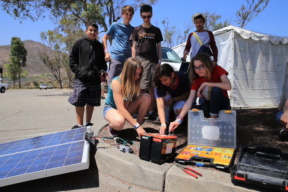 Students building solar panels
